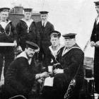 A time-honoured custom in the British Navy: handing out grog on board a destroyer. — Otago...