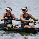 Genevieve Behrent (left) and Rebecca Scown, of New Zealand ,compete in the women's pair heats at...
