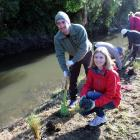Sonya Lewthwaite and husband Jon Screech plant out the banks of a stream in Waiwhetu, Lower Hutt,...