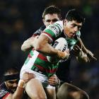Kyle Turner carries the ball for Souths as Ryan Hoffman tries to tackle him. Photo: Getty Images