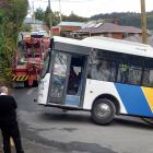 A bus is well and truly stuck on Buccleugh St, in Dunedin, yesterday afternoon. PHOTO: STEPHEN...