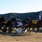 Stunin Dude (8) kicks home ahead of a wall of horses to win the Kurow Cup at Oamaru yesterday....