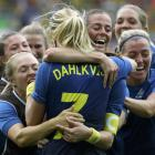 Sweden's Lisa Dahlkvist celebrates with her team after kicking the winning penalty. Photo: Reuters