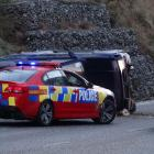 This vehicle overturned in Gorge Rd, Queenstown, yesterday morning. Photo by David Williams.