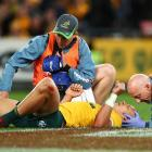 Matt Toomua of the Wallabies receives attention from trainers during the Bledisloe Cup Rugby...
