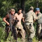 Turkish soldiers detain one of the missing military personnel suspected of being involved in the...