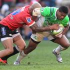 Waisake Naholo tries to break a tackle for the Highlanders against the Lions. Photo: Getty Images