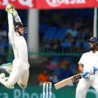 New Zealand wicketkeeper B-J Watling leaps for the ball after India's Murali Vijay avoids a...