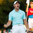 Rory McIlroy celebrates his win on the final playoff hole of the Tour Championship at East Lake...