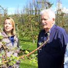 Orchardist Con van der Voort (centre) tells  Port Otago customer service co-ordinator Trish Reid ...