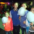 Candy floss was on the menu at the Blossom Festival Mardi Gras for Chatto Creek girls (from left)...