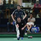 Southland's Shane Elliott delivers a bowl while his opponent Andy McLean looks on at the PBA...