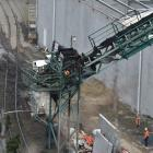 Port Otago staff assess the damage, following a fire on a Port Otago conveyor belt yesterday....