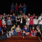 About 30 years 7 and 8 pupils crowded together at a Superhero-themed disco party organised by the...