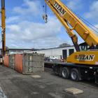 A KiwiRail flatbed wagon carrying two coal containers derailed at the Dunedin Railway Station...