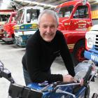 Classic Motorcycle Mecca curator Dave Roberts, at Bill Richardson Transport World with a 1970s...
