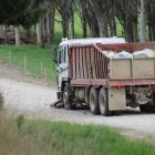 A motorcycle lies in front of a truck following a collision near Wallacetown this morning. Photo:...