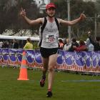 Jonah Smith acknowledges the crowd as he crosses the finish line at Port Chalmers to win the...