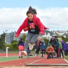 Grace Arthur (7) competes in the long jump. Photo by Gregor Richardson.