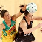 New Zealand's Bailey Mes (R) and Australia's Sharni Layton compete for the ball.  Photo Getty