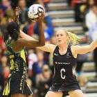 Adean Thomas of Jamaica with the ball and Laura Langman of the Silver Ferns. Photo: Getty Images