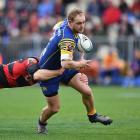 Matt Faddes on the run for Otago as the Canterbury defence wraps him up. Photo: Getty Images