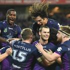 Melbourne Storm players celebrate Cheyse Blair's try. Photo Getty