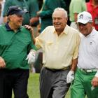 Arnold Palmer with fellow golfing greats Jack Nicklaus (L) and Gary Player (R) during the annual...