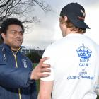 Otago University Seafarers captain Jake Maiono admires the shirt to be used by his team, as worn...