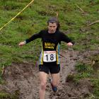 Sabrina Grogan negotiates the mud during the Leith cross-country relays earlier this year. Photo:...