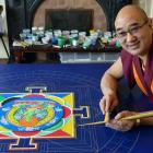 Dhargyey Buddhist Centre resident teacher Geshe Lobsang Dhonyoe creates a sand mandala in the...