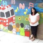 Angela Middlemiss stands in front of a mural painted in her son Nathan Booker's honour at the IHC...