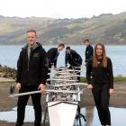 New Otago Boys' High School coaches Jamie McKenzie (left) and Charlie Turner, and rowers (at rear...