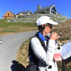 A volunteer at the Millbrook Resort golf course during this year's New Zealand Open. PHOTO:...