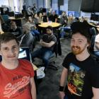 Rocketwerkz founder Dean Hall (left) and communications director Will Overgard stand in front of...