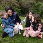 Kaiah Hiko (6), Otago SPCA dog manager Lisa Gerard, Zita (7) and Poppy Lamare (9) meet  Pearl, a...