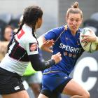 Otago fullback Hannah Stolba tries to fend off North Harbour winger Florida Fatanitivake at...