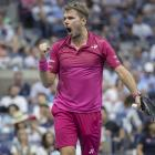 Stanislas Wawrinka reacts during his match against Novak Djokovic at the US Open tennis...
