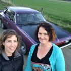 Dunedin Rev 'n' Ride organisers Janine Bolton (left) and Tracy Chambers with Ms Chambers' 1971...