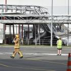 A firefighter walks from the scene of  a silo collapse at  the Fonterra Edendale plant yesterday....
