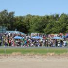 The crowd enjoys the sunshine at a previous Omakau trots. Photo by ODT.