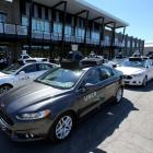 A fleet of Uber's Ford Fusion self driving cars are shown during a demonstration of self-driving...