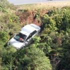 Three people have been rescued from a rental car which went over a cliff south of Westport. Photo...