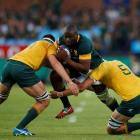 South Africa's Teboho Mohoje tries to bust through the Australian defence. Photo Reuters