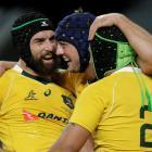 Australia's Dean Mumm (C) celebrates after scoring a try. Photo Reuters