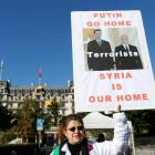 A woman protests outside the Beau-Rivage Palace during the Syria talks in Lausanne. Photo Reuters
