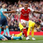 Arsenal's Theo Walcott celebrates after scoring their first goal. Photo: Reuters