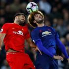 Liverpool's Emre Can (L) contests the ball with Manchester United's Marouane Fellaini. Photo:...