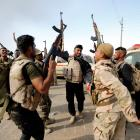 Iraqi security forces celebrate after the liberation of Khalidiya village from Islamic State...