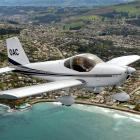 Otago Aero Club president Colin Chalmers takes to the skies above the Dunedin coastline in the...